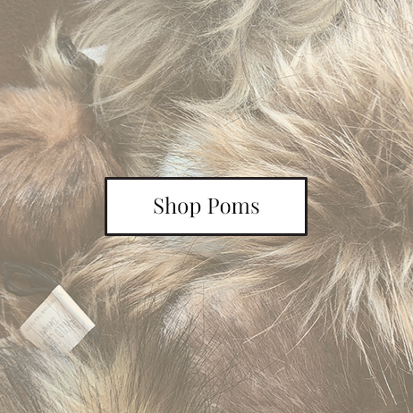 Shop poms at your local yarn and knitting store all strung out